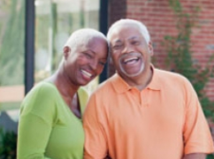 older-african-american-family-in-front-of-house