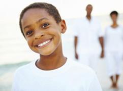 promise neighborhoods little boy with family